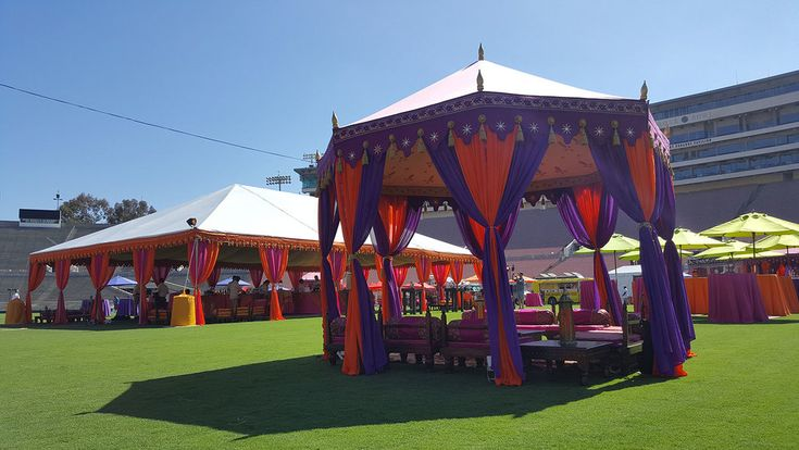 Taking place at the Rose Bowl in Pasadena made this an event we just had to share. The corporate event was planned by Penny Barr Events, and featured a very colorful collection of tenting and decor. We loved the way the colors came together in the space and worked with the fabulous expanse of grass and perfect blue Californian sky.