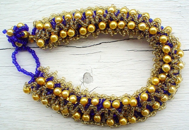 """Gold and Cobalt Ribbon bracelet features Swarovsky Pearls and seed beads. 7"""""""