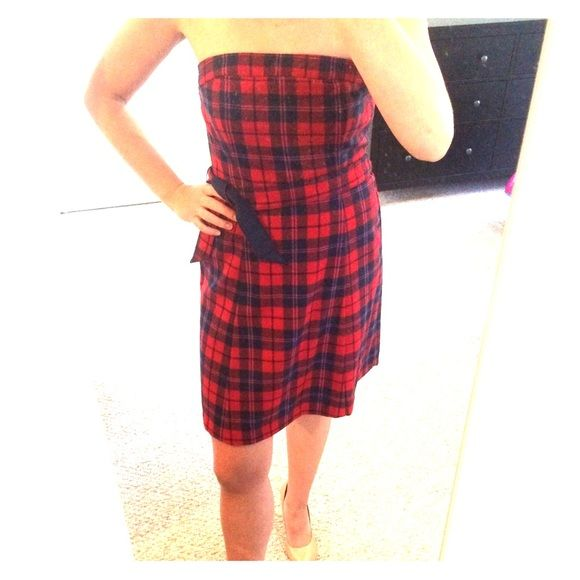American Eagle Winter Cocktail Dress American Eagle Winter Cocktail Dress. Size 6. Strapless, lined, side zip closure with button detail. Dark blue and red flannel. Great for the holidays! Worn once to a Christmas party and got tons of compliments! American Eagle Outfitters Dresses