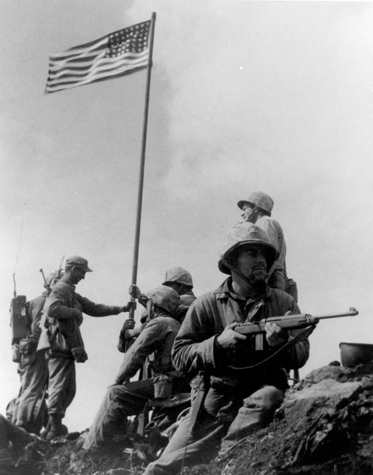 FEB  23 1945 U.S. Marines raise the flag on Mount Suribachi - See more at: http://ww2today.com First Iwo Jima Flag Raising. Small flag carried ashore by the 2d Battalion, 28th Marines is planted atop Mount Suribachi at 1020, 23 February 1945