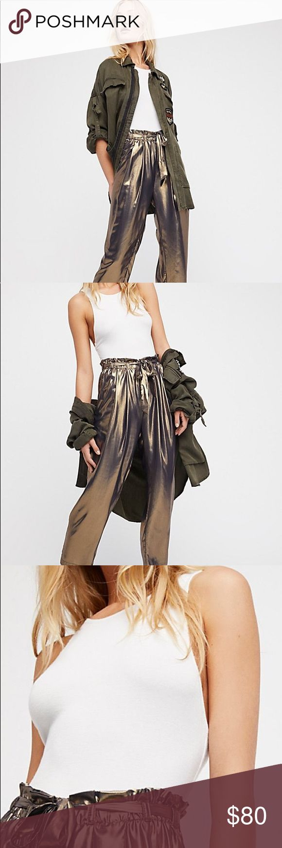 Free people metal Harlem pants Metal look harem pants from FP.Semi sheer fabric with elastic waist and front tie . 100% polyester . Hand wash only. Waist 30.5, rise 13, hips 50 , inseam 25. Brand new. Free People Pants