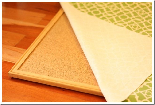 Love this idea because it works on a cheap board with a frame. DIY fabric covered bulletin board.
