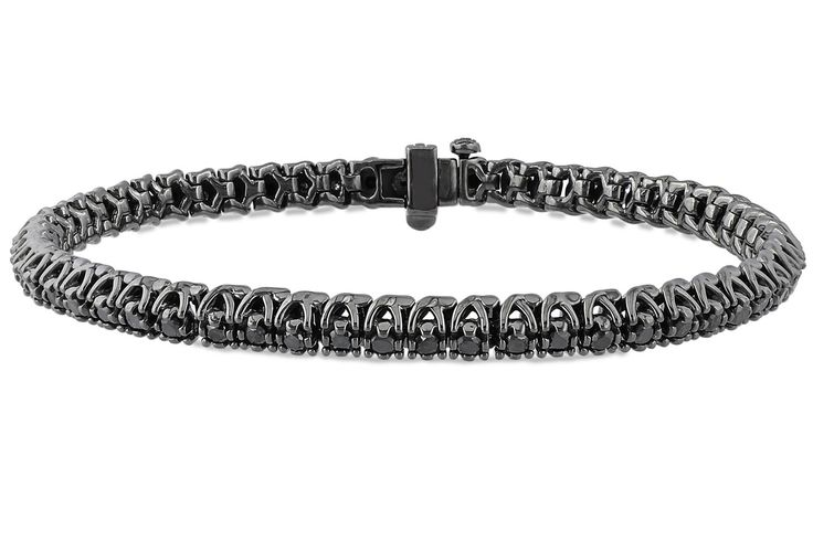 Wear this edgy bracelet to give sleek city separates a luxe finish. 1 full carat of round cut enhanced black diamonds are prong set in hot black rhodium plated sterling silver.