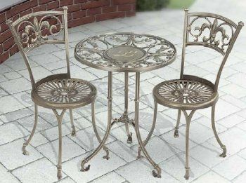 """Monogram Metal Table and Chairs Outdoor Bistro Set by Whitehall. $589.99. Table: 22 L x 22 W x 28 H inches. Includes one monogram table and two chairs. Chair: 15 L x 15 W x 33 H inches. Material: Aluminum and Glass. WHAT'S INCLUDED:Bistro TableTwo Bistro ChairsWith graceful scrolls and Fleur de Lys ornaments, these tabletop designs are tributes to French ornamental ironwork. Translated from French as """"lily flower,"""" the Fleur de Lys is a stylized iris, or lily symbol, that stands ..."""