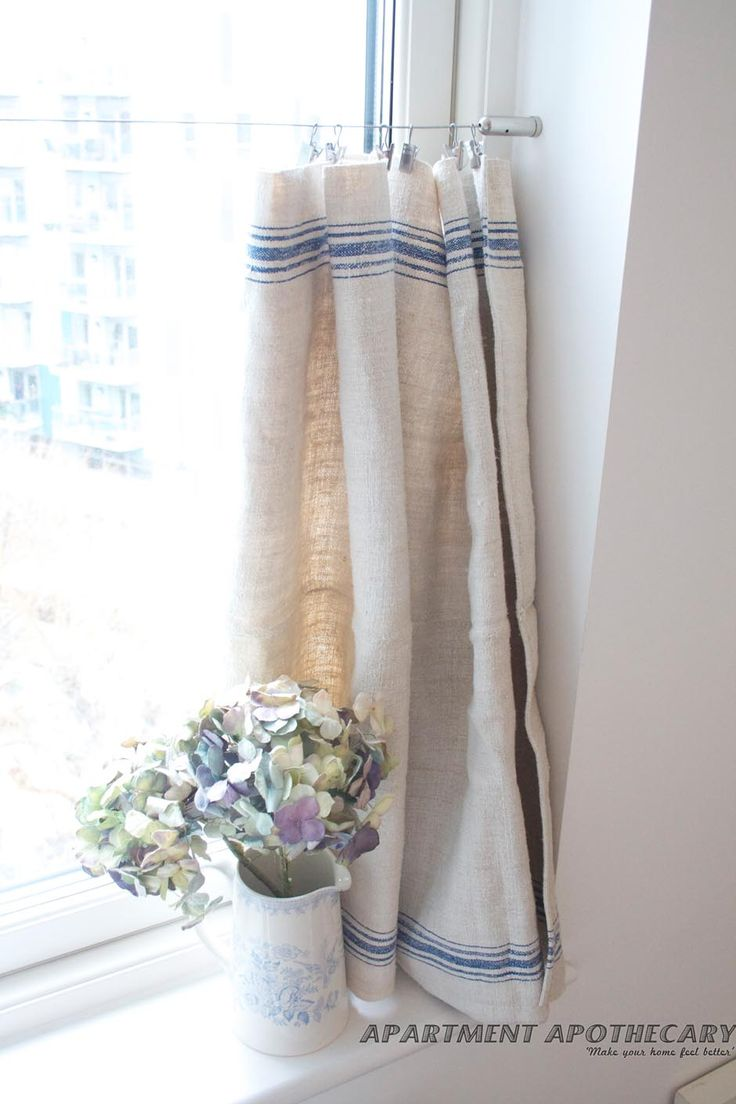 Delightful French-style, no-sew curtain using one grain sack (eBay)  and a curtain wire and clips (Ikea).
