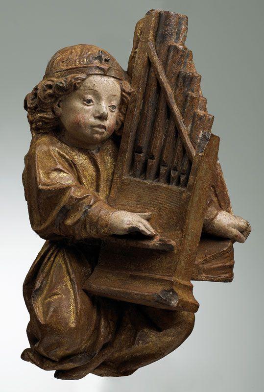 Anonyme, Ange jouant de l'orgue, 1401-1500, Calcaire, polychromie, taille directe, Inv. 49 6 124. Exposée. Salle capitulaire. © Toulouse, musée des Augustins – Photo Daniel Martin