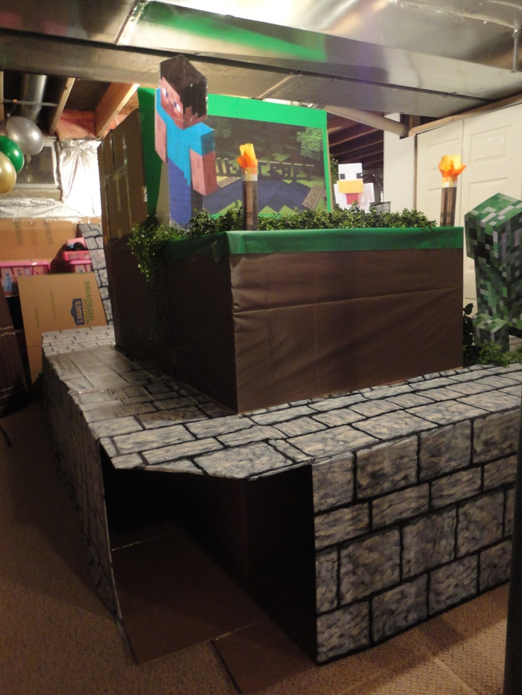 """Minecraft fort. It was made with 28 cardboard boxes. Inside are tunnels and a """"cave"""" in the center big enough for a 5'10"""" person to stand up in. The bottom row was wrapped with scene setter plastic covering from a party store."""