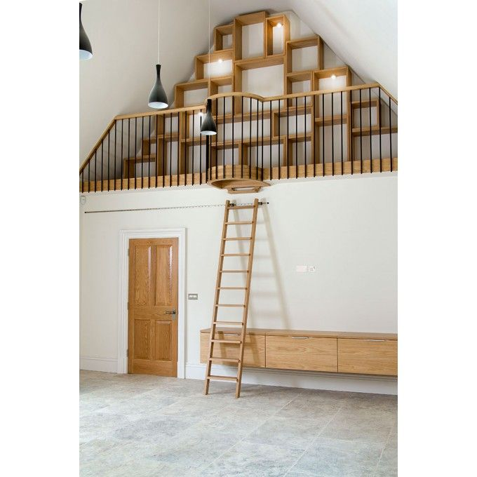 This is in a new build at the end of the kitchen in a vaulted area. Rather than build a straight wall, we put in a 'twist' on a traditional library ladder. The problem was in the geometry of making the ladder stand vertically under the cantilevered floor, but still pull out to a suitable angle.  http://www.ladderstore.com/special-access/rolling-ladders/rolling-ladders.html