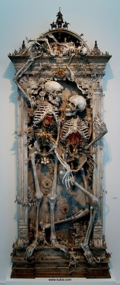 I always tell myself I will go the day after Halloween and buy up all the left over skeletons, cauldrons, and other 'larger' spooky items so I can construct things like this. I NEVER do it.