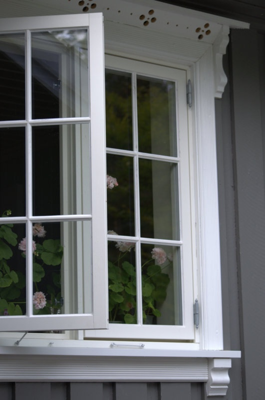 Old Chic - love the window trim and always appreciate flowers on a windowsill.