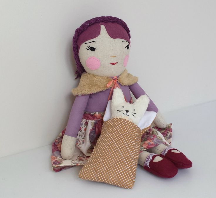 This handmade, one of a kind, heirloom cloth doll is named Rose. Rose is approximately 43 cm (17 inch) tall. She has a cute little pet bunny rabbit (16.5 cm or 6.5 inch tall). She is dressed ...