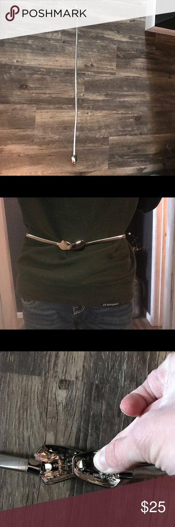Steve Madden Silver Cobra Stretch Belt A silver belt from Steve Madden. It clasps in the front together. I originally intended it to be a waist belt for dresses but it was too large for me. Very good quality and heavy belt. It is a small/medium size. Steve Madden Accessories Belts