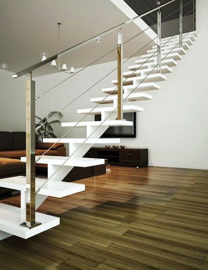 Escalera de eje central blanca barandilla moderna for Huecos de escaleras modernos