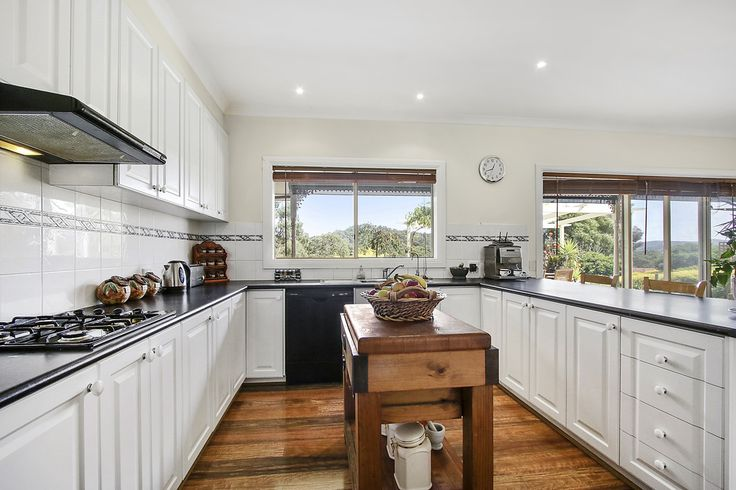 This kitchen works a treat. Deep bench for brekky and chats. Plenty of cupboard space and a very airy and light kitchen with an outlook to the arbor setting and beyond. This kicthen has GREAT views. It also features a walk-in pantry and family dining behind the serving bench.....  Also big enough for the chopping block....