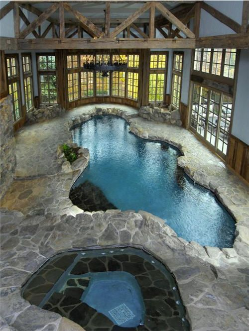 Wow! Here again bringing outdoor components inside ~ this beautifully designed enclosed pool and hot tub is perfectly complimented by the rugged stone flooring and rustic beams overhead. Not to mention the surrounding walls of windows and doors!