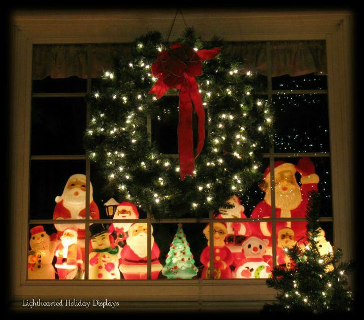Small vintage Christmas blowmolds displayed in front window. (Another idea  I wish Iu0027