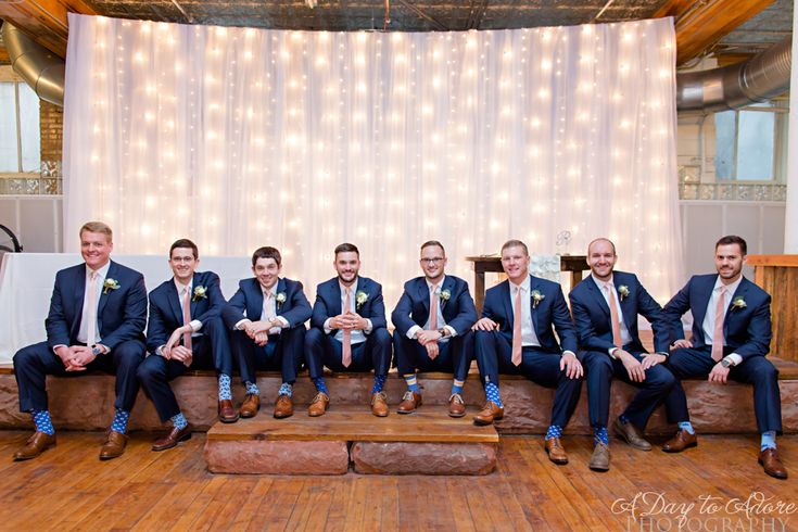 Chappelow Events Real Wedding   Navy, Blush and Gold Wedding   Kansas City   Rumely Historic Event Space    Handsome groomsmen in navy with blush ties, sporting fun socks that were a gift from the groom. Photo: A Day to Adore Photography & Invitations @deannajohnson