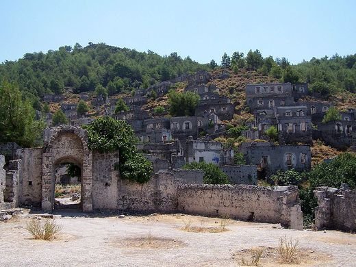 Kayakoy, TURKEY - From the 1700s, Karmylassos (in Greek) was home to 20,000 Greek Orthodox residents by early 20th century. The collapse of the Ottoman Empire led to the land grabs of the Greco-Turkish War (1919–1922). The residents, who had lived peacefully with their Turkish neighbors, abandoned the town and went to Greece. 350 homes now sit empty and mostly roofless, along with two Greek Orthodox churches and the fountains and cisterns that watered the city.