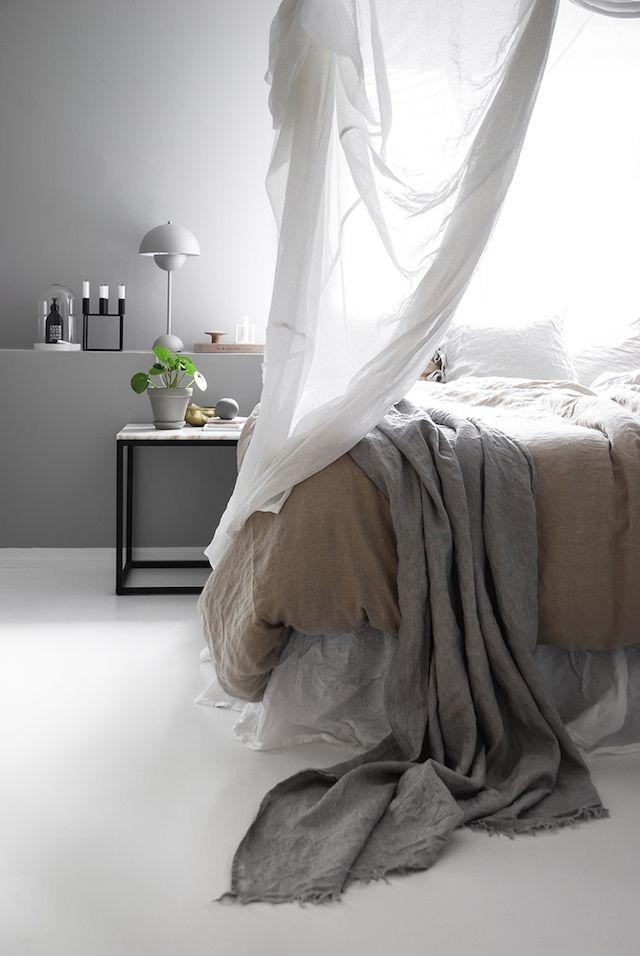 Light grey bedroom in the beautifully serene Norwegian home of Katerina Dima.