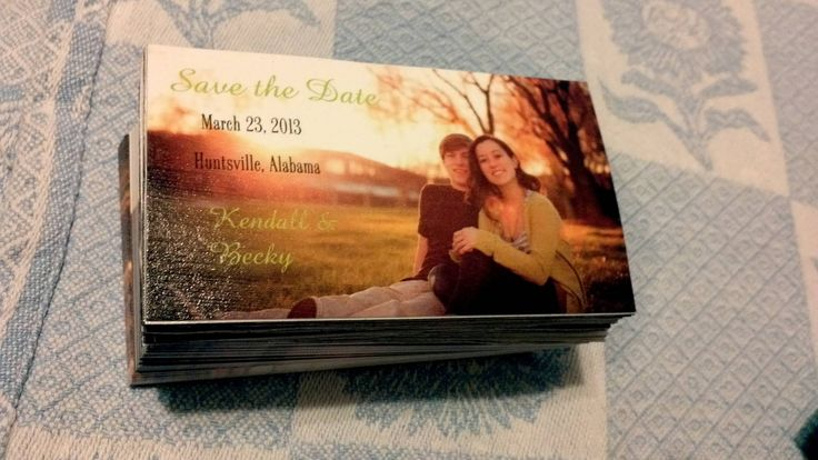 DIY save the date magnets. Business cards ($12)modge podged onto magnet sheets($3)..total cost of 250save the dates,under 20 bucks :)