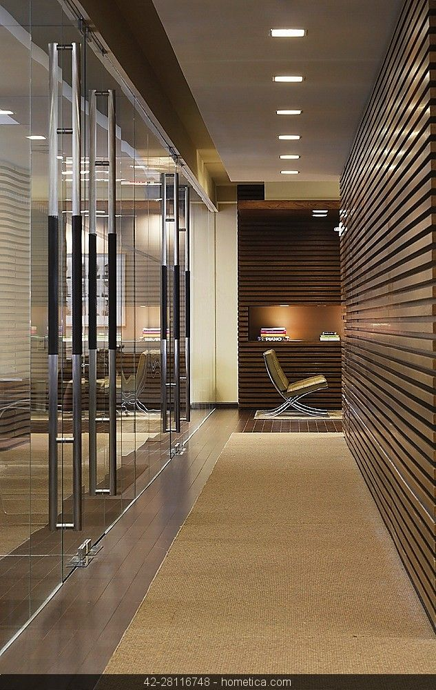 contemporary modern minimalistic entrance hallway, office with wood panel recess light wood and carpet floor