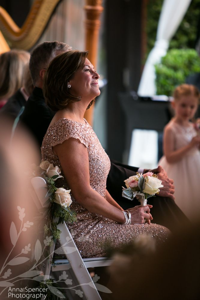 Anna and Spencer Photography, Atlanta Documentary Wedding Photographers. Photograph of the Mother of the Bride During her daughter's wedding ceremony in Savannah.
