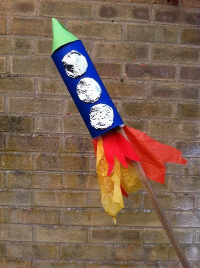 homemade Rocket with toilet paper tube, construction paper, tissue paper, foil and glue