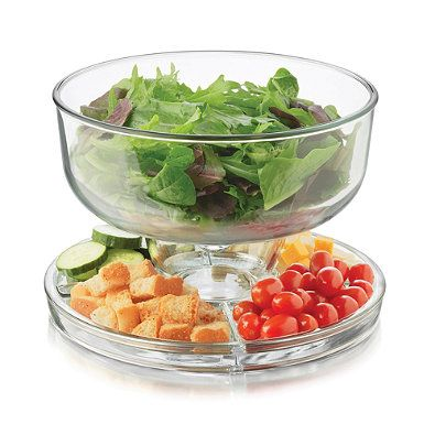 This ultra useful Six-in-one Server is a cake dome and lid, punch bowl, covered crudite with dip server, hors d'oeuvres plate with dip server, salad bowl with vegetables underneath, and simple pie or cake plate.