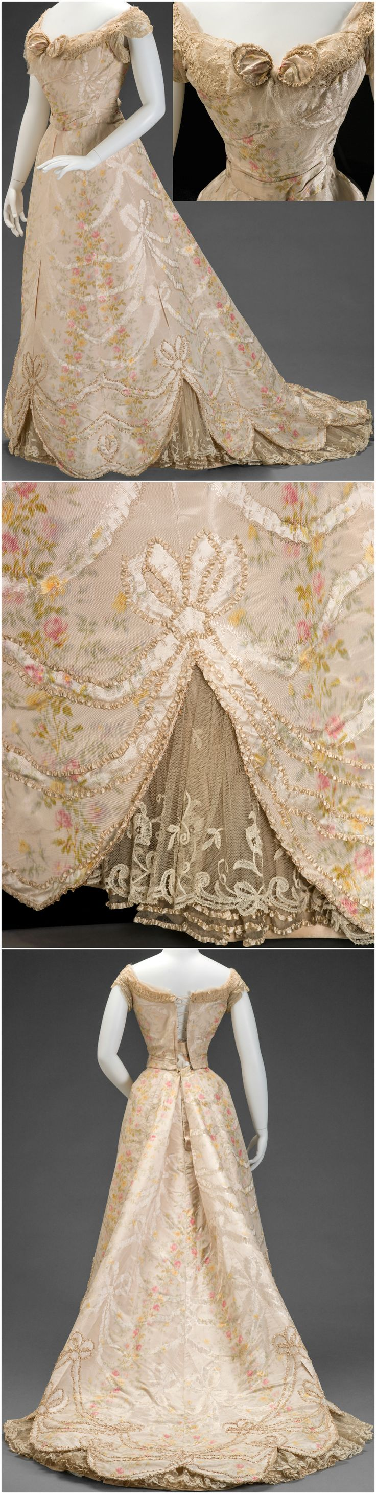 """Ball gown, by G. and E. Spitzer (Austrian), about 1900, at the Indianapolis Museum of Art. IMA: """"This expensive fabric was produced in Lyon, France. The elaborate surface decoration was achieved by a combination of printed warps (chiné), woven bows and swags, and then the fabric was finished with a watered silk (moiré) effect... This gown was worn by India Harris, wife of Addison C. Harris, Ambassador to Austria from 1899 to 1901."""" CLICK THROUGH FOR VERY LARGE, HI-RES IMAGES."""