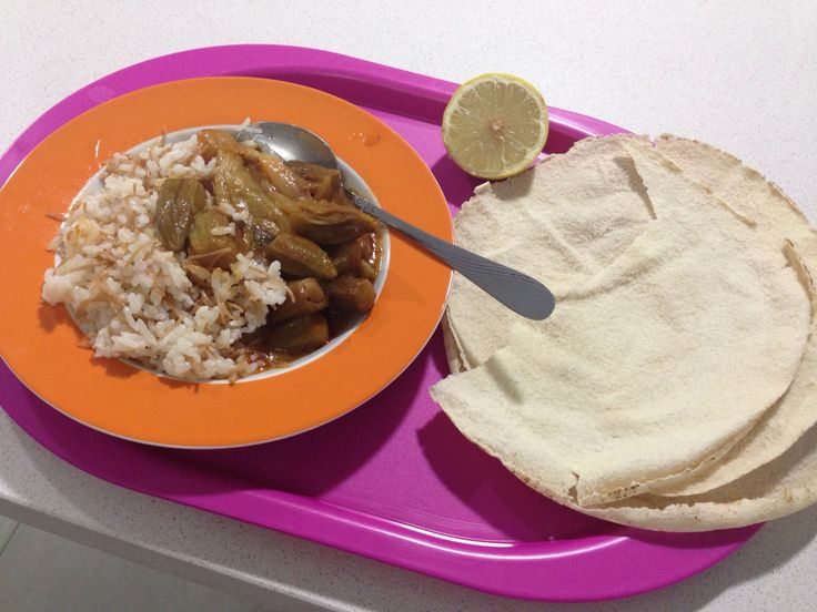 """Bemieh w rizz Okra cooked with eggplant, 1 onion 2 clove of garlic, bit of fresh coriander & small cubic pieces of meat"""" and cooked rice on the side Pure Lebanese Food"""
