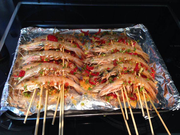 Asian style BBQ skewered prawns