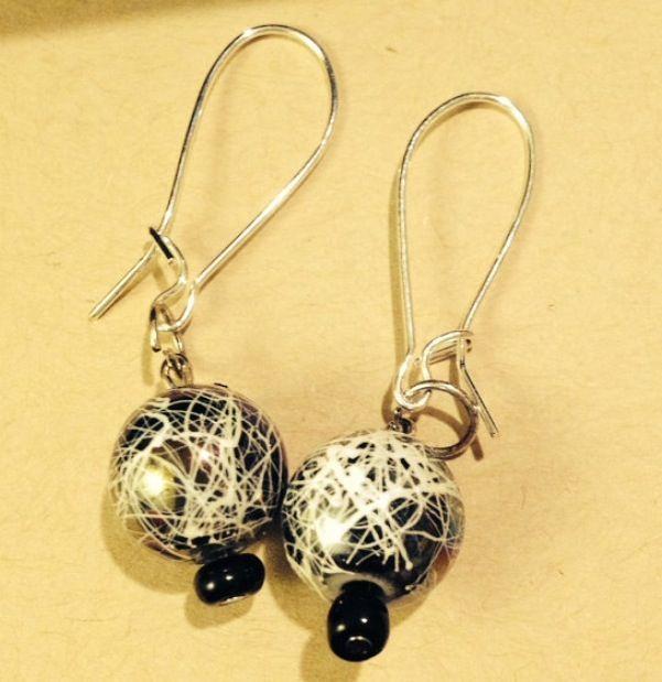 Let darkness tremble.  Universe pattern bead earrings.  Silver sterling earring hooks.  $20  Www.sozojewellerydesigns.com