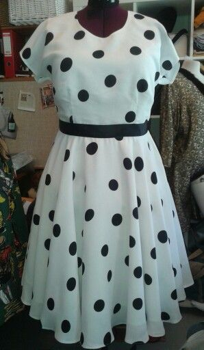 Dress in 50's style.