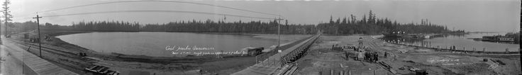 1917 panoramic view showing Lost Lagoon, the Stanley Park Causeway under construction, and the Vancouver Rowing Club.