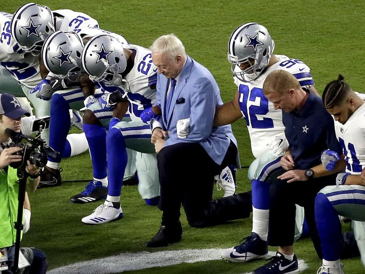 Jerry Jones surprised many on Monday night by kneeling with Cowboys players and coaches before the playing of the national anthem.