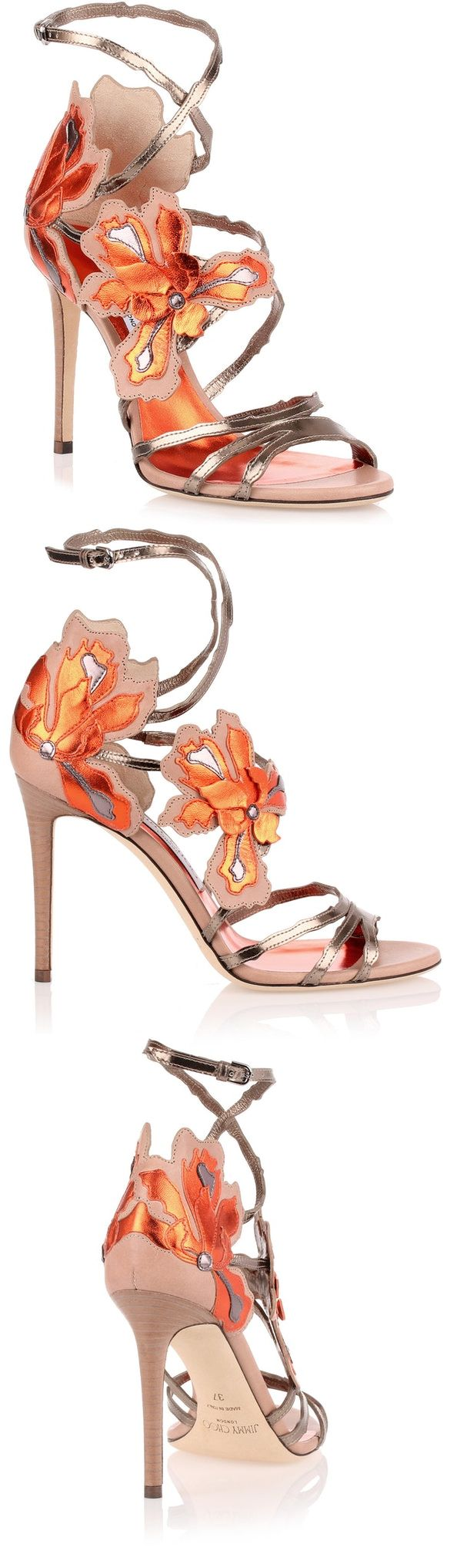 Jimmy Choo Lolita 100 orange metallic sandal strappy shoes. Metallic Silver leather sandal with orange flame tonal flower details. The Lolita has stiletto heel, and an adjustable ankle strap with 'branch cutwork shapes' detailing. Leather sole. Made in Italy. Pop Orange Tonal Colours on Silver. Great with Nude Outfits, Orange Outfits, or as a colour pop with Grey Silver. #racingfashion #fashion #shoes #shoesday #affiliatelink #fashionsonthefield #colourpop #wearorange