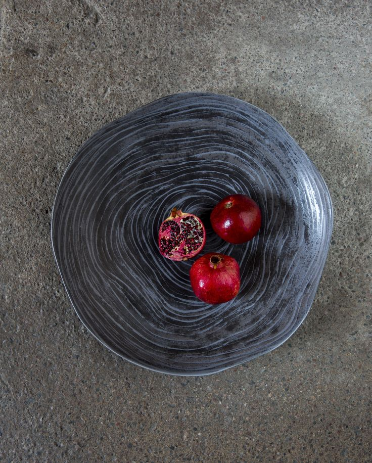 Kivi Plate | Designed by Anu Pentik, this plate is a part of Kivi (Stone) tableware series that brings firmness and minimalism to your table setting with its dark essence. Interspersed with the sweet colour scheme of Kallio astiasto, Kivi catches your eye in a magnificent way. Made in Posio, Finnish Lapland.