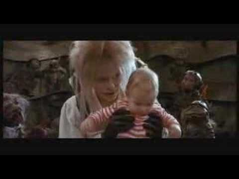 This is the great magic dance from the movie Labyrinth (1986) featuring super dancing from David Bowie and a coke snorting spell suggestion.  I sang this to the kids when they were crying babies, and danced them around.