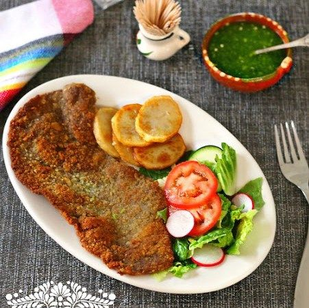 """Today we have a Milanesa recipe. """"Milanesa"""" refers to a thin cut of meat that is breaded and pan fried, and then served with fried potatoes, a salad, and sometimes rice and beans. It is considered a main dish in many states of México and other Latin American countries, where it is a favorite with...Read More"""