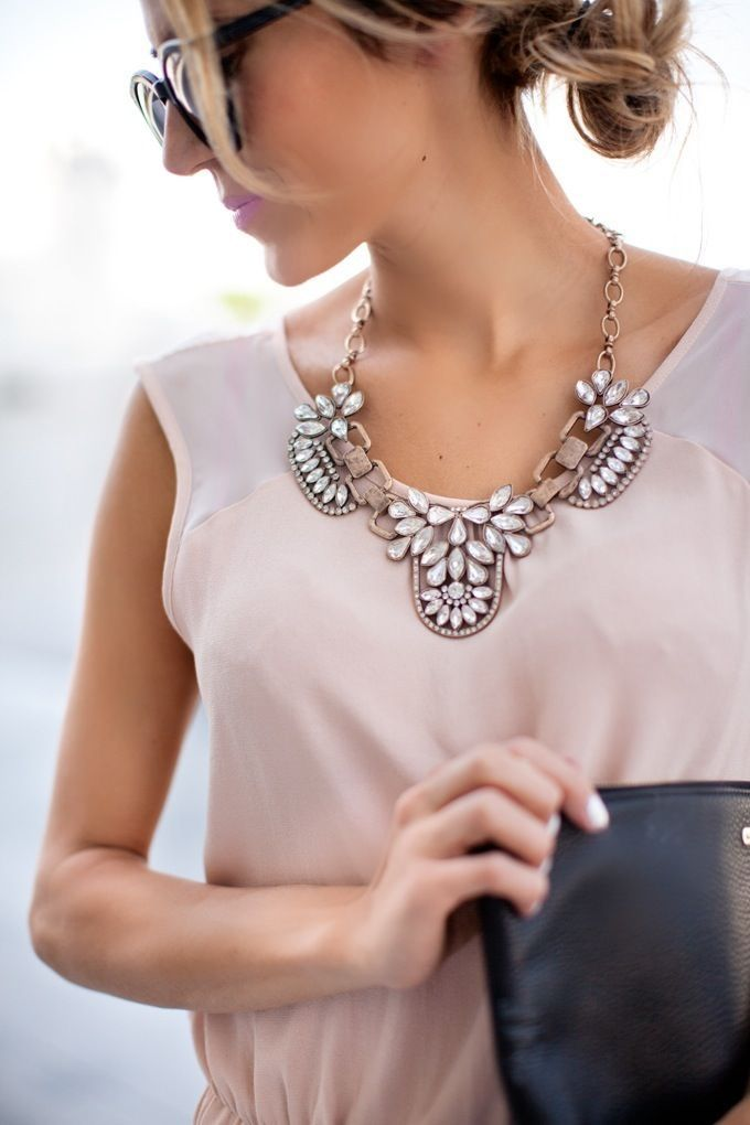 if your goal is to use your statement necklace to simply liven up and brighten up a plain top / dress, take the minimalistic route and wear it plain and simple. This means to wear your statement necklace with either no other jewelry or with very minimal jewelry like stud earrings or dainty chain bracelets.