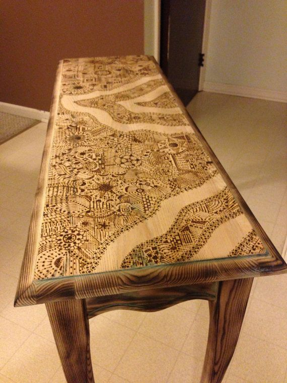 @Megan Ward Ward Ward Martin damn this is beautiful. we could get a more simple one, and burn it ourselves. or have my mom do her art on it haha. i <3 wood burning tools. of course this comes from buffalo, Ny ;)  wood burned sofa table $800