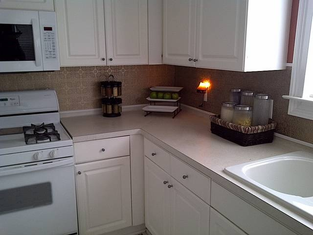 I made a tin look back splash for my kitchen i bought all for Yellow wallpaper home depot
