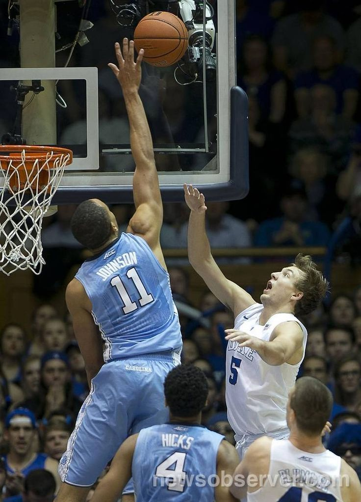 North Carolina's Brice Johnson (11) blocks a shot by Duke's Luke Kennard (5) during the second half on Saturday, March 5, 2016 at Cameron Indoor in Durham, N.C.
