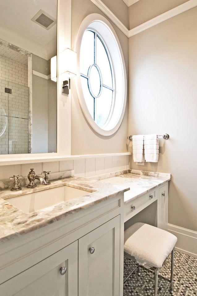 vanity area with circle window and granite counter top designinspiration homedecor bathroom makeup lighting