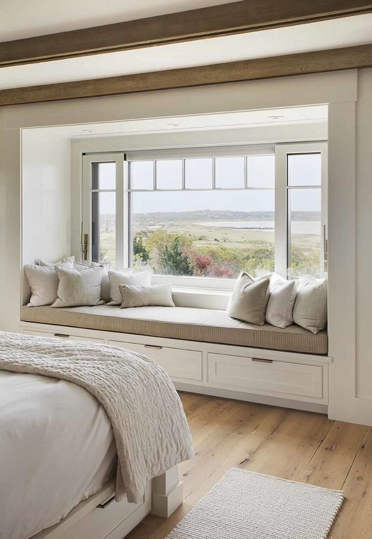 A window seat gives a lovely relaxing space in this master bedroom . >>> window  seat with a view :: gorgeous beach house in Martha's Vineyard with  barn-like ...