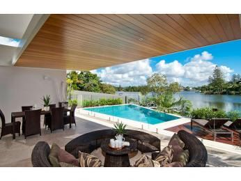 Endless pool design using natural stone with decking & outdoor furniture setting - Pool photo 179844