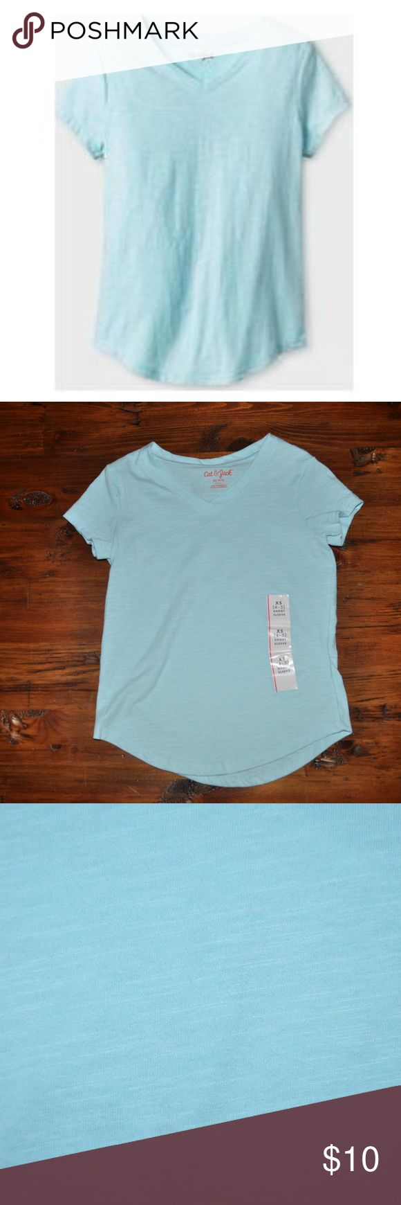 New CAT & JACK V-neck Favorite Tee - Turquoise Updated her wardrobe basics with the Girls' Solid Color V-neck Favorite Tee by Cat & Jack. From shorts to jeans and everything in between, this basic girls' t-shirt might just be her trusty new BFF.   available in size XS (4/5) | M (7/8) | XL (14/16) condition: new without tags color: turquoise glass  @cjrose25  bundle your likes for a private discount Cat & Jack Shirts & Tops Tees - Short Sleeve