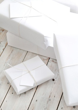 all white packages. by follow studio