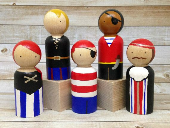 Pirate Peg Doll Set...Try your hand at swashbuckling with this set of 5 sea-worthy pirates. Because they are not themed to any movies or tv shows, they provide room for the imagination to take over! They stand 2 1/2 inches tall, and have two coats of non-toxic varnish to keep them safe.