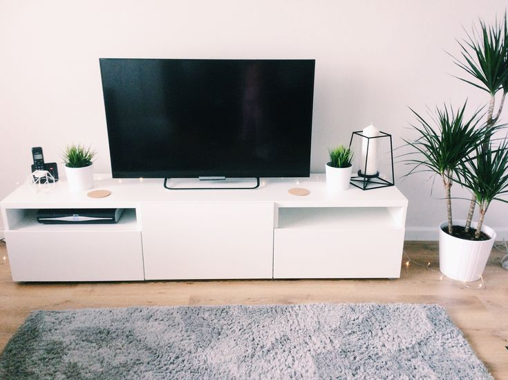 My new living room. Minimal look. Plants, besta tv unit and cork coasters from ikea. Black frame candle holder from tesco